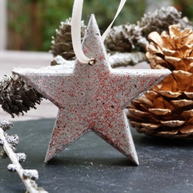 Grey concrete hanging star with red glitter